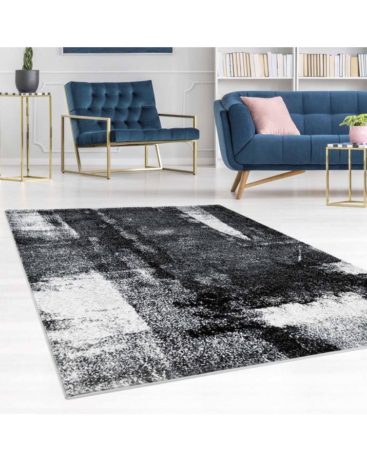 Vintažinis tamsių spalvų kilimas