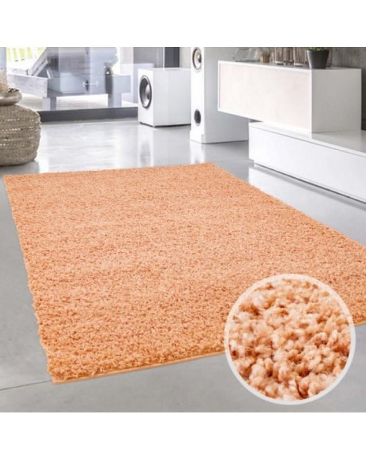 Oranžinis minkštas kilima..