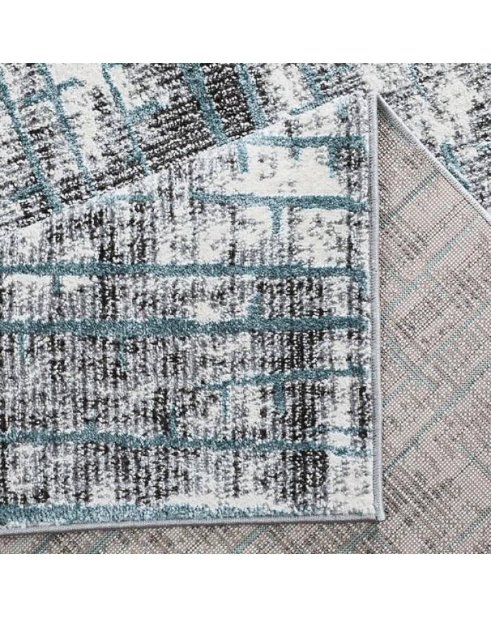Unikalaus dizaino kilimas su mėlynu akcentu